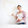 pregnant-woman-painting-nursery-horiz